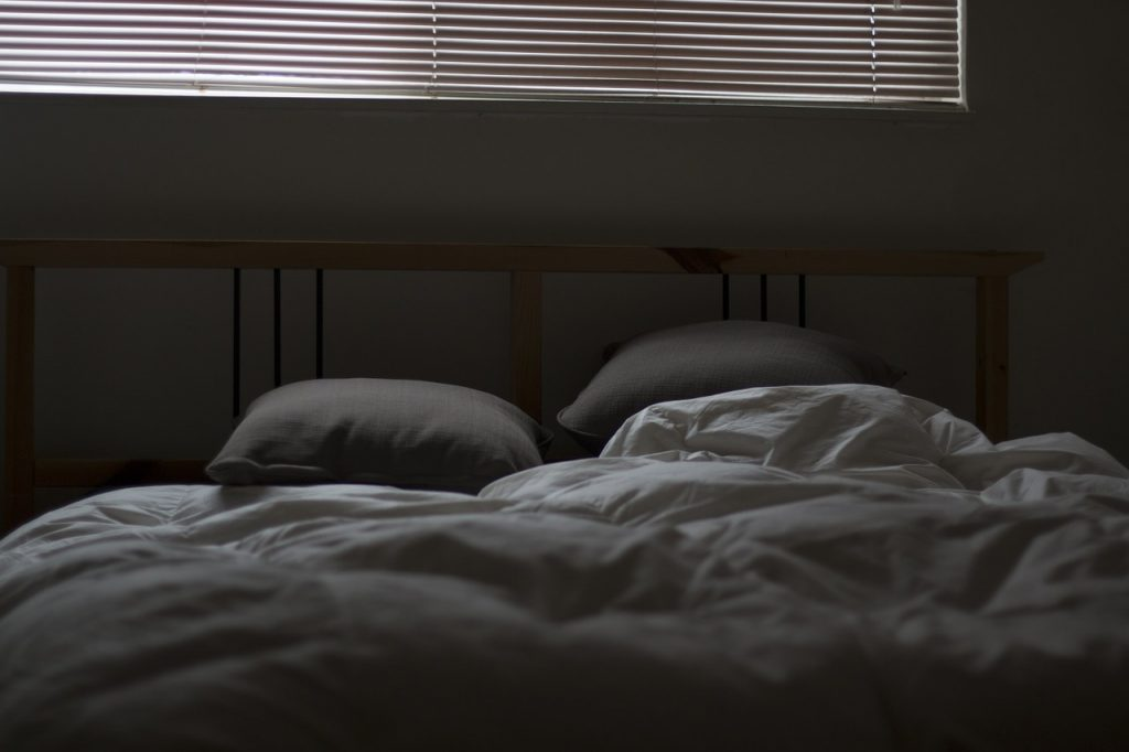 dream meaning bed someone
